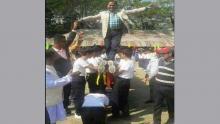 """Upazila chairman sued for walking over  """"human bridge"""""""