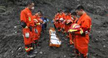 Hopes dim in search for 93 buried by China landslide