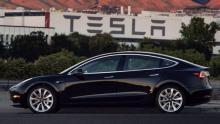 Elon Musk unveils first Tesla Model 3 production unit