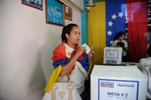 Woman, 61, shot dead in Venezuela voting queue