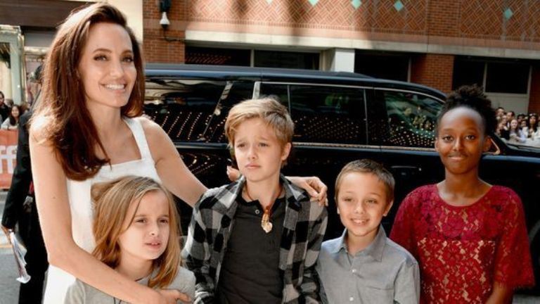 Jolie brings her kids out for film premiere, daughter Shiloh looks like a young Brad Pitt