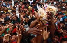 Myanmar protesters try to block aid to Rohingyas