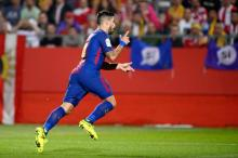 Barca remain perfect in Girona