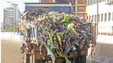 HC for transporting garbage on covered van
