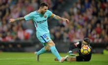 Messi maintains Barca's lead over resurgent Valencia