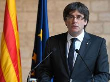 Sacked Catalonia leader surrenders to cops