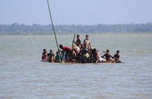 Rohingya use plastic rafts to flee Myanmar