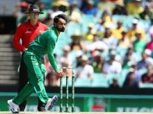 Hafeez banned from bowling in international matches