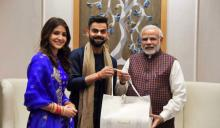 Virat, Anushka meet PM Modi, invite him for wedding reception
