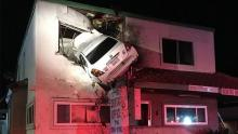 Car flies 20m into upper floor of building in California