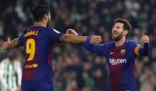 Messi, Suarez score twice as Barcelona extends league lead