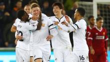 Battling Swansea shock Liverpool
