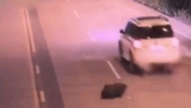 Drunk man falls out of car, wife doesn't realize