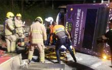 At least 18 killed as bus topples over in Hong Kong