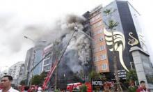 Smoky condo fire in Vietnam kills at least 13, injures 28