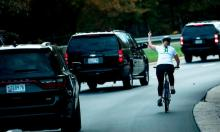 Cyclist who lost job after giving Trump finger sues former employer