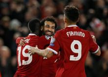 Five-star Liverpool gives Roma lifeline