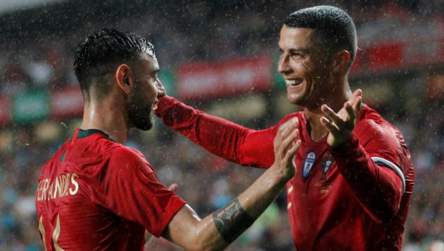 Ronaldo return inspires Portugal past Algeria