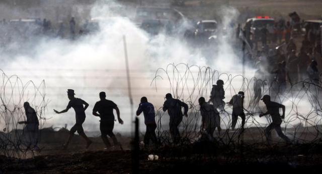 Israeli troops kill 4 Palestinians as Gaza protest resumes