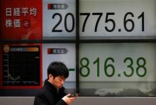Asian markets mostly up but trade war fears keep dealers on edge