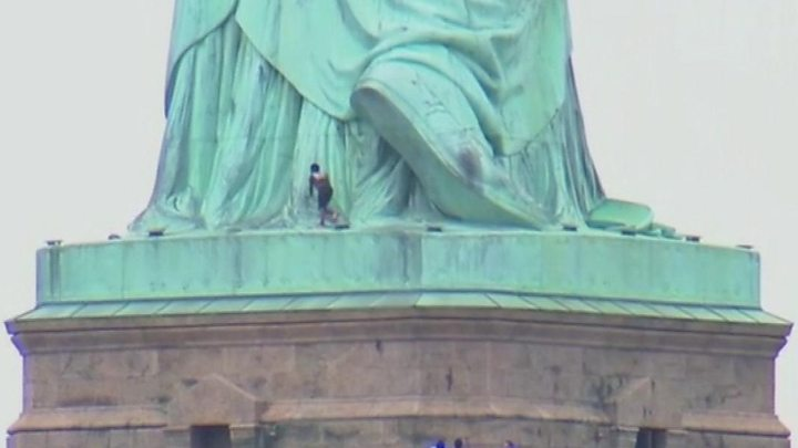 Statue of Liberty evacuated after woman climbed monument base