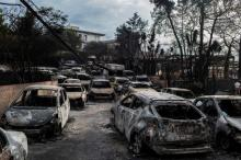 Greeks mourn as wildfires kill 74