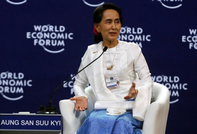 Suu Kyi defends jailing of Reuters journalists