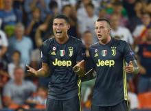 Ronaldo sent off but 10-man Juventus ease past Valencia