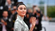 Fan apologises after China slaps $129m fine