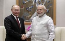 Putin talks arms, nuclear deals in India