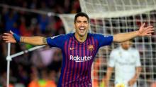Suarez hits hat-trick as Barca blow away Real