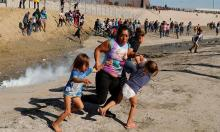 US agents fire tear gas at migrants trying to cross from Mexico