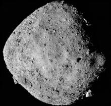 NASA probe finds signs of water on nearby asteroid