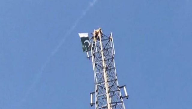 Man climbs mobile tower in Pakistan, demands PM post
