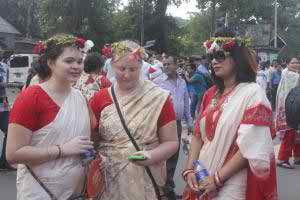 Foreigners are celebrating Pahela Baishaikh wearing sari in the capital on Thursday.     photo: bbarta24 net