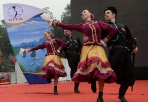 Russian dancers perform a traditional dance during an international tourism fair, the \