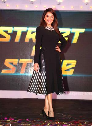 Madhuri Dixit looked beautiful in a black Bibhu Mohapatra flared dress at the press meet of So You Think You Can Dance. The actor finished out the look with a chunky VelvetCase necklace, black heels and a pop of pink lipshade. (Photo: Varinder Chawla)