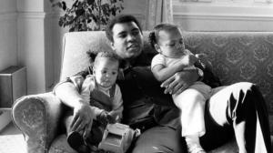 Muhammad Ali is seen cuddling his daughters Laila, (L ) and Hana (R) at a Hotel in London, Britain December 19, 1978.                                      Photo Reuters
