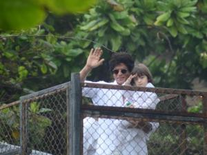 Shah Rukh Khan and his son AbRam greet fans at Mannat, SRK's house in Mumbai on the occasion of Eid on Thursday.