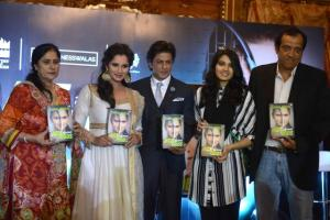 Indian Bollywood actor Shah Rukh Khan (C) and tennis player Sania Mirza (2L) pose with members of the Mirza family during the release of \
