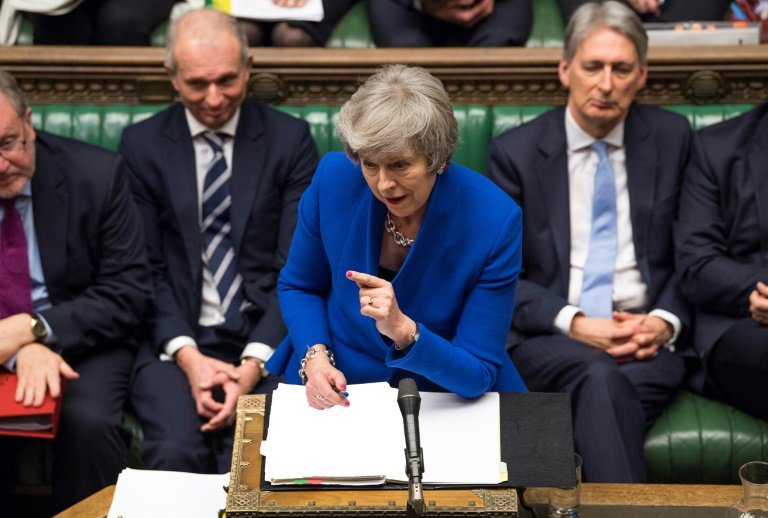 May reaches out to rivals after winning confidence vote