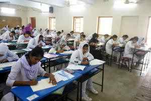 Students writing their answer scripts in one of the HSC examination halls at the Viqarunnisa Noon School and College in the capital on Sunday, the first day of the examinations. Over 1.2 million students are sitting for the exam this year. Photo: bbarta24.net.