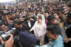 BNP Chairperson Khaleda Zia on her way to court to appear before it in five cases in the capital on Tuesday.