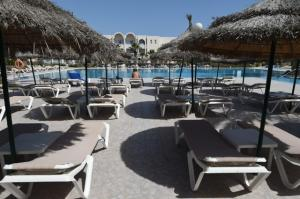 A tourist sits on a sunbed next to a hotel pool on the Tunisian resort island of Djerba on May 26, 2016. Before the 2011 revolution, the annual number of visitors in Tunisia reached nearly seven million, with tourism accounting for some 7 per cent of the gross domestic product (GDP). AFP Photo