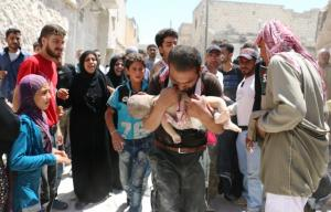A Syrian man holds the body of his child after it was taken from under the rubble of destroyed buildings following a reported air strike on the rebel-held neighbourhood of al-Marjah in the northern city of Aleppo, on July 24, 2016. Air raids have hit four makeshift hospitals in Syria\'s battered Aleppo city, doctors said, jeopardising medical care for more than 200,000 desperate civilians in rebel-held areas. AFP Photo