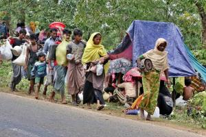 To save their lives from the atrocities of Myanmar government forces, Rohingyas of all ages leave Rakine State and enter Bangladesh in long queues at Teknaf in Cox's Bazar.